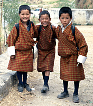 In Bhutan, three young boys on their way to school.